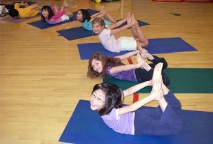 kids enjoy yoga especially these kinds of poses such as the bow pose in this picture.